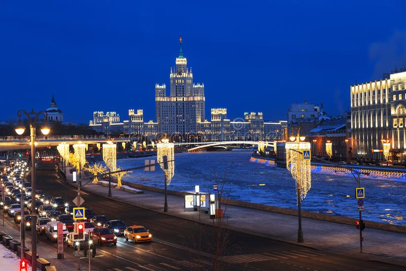 View of the night winter Moscow with the Moscow river and high-rise building on Kotelnicheskaya embankment. royalty free stock photos