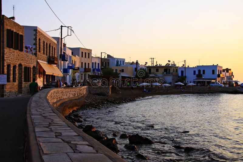 Summer sunset on the volcanic island of Nisyros. Summer sunset in Mandraki, Nisyros island, Greece, creating beautiful orange colours on the houses and the sea stock photos