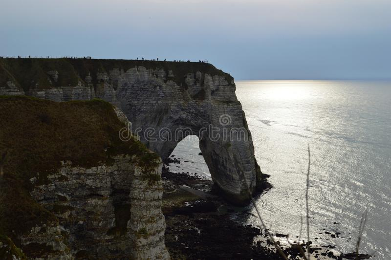 View of Normandy`s cliffs Etretat - sunset. nature, ocean, rock and sky. royalty free stock images