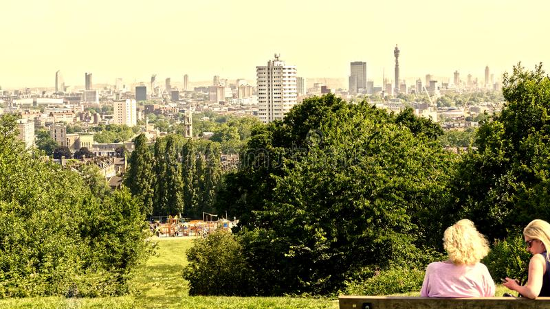 View of London from Parliament Hill, Hampstead Heath June 2019 with people royalty free stock photo