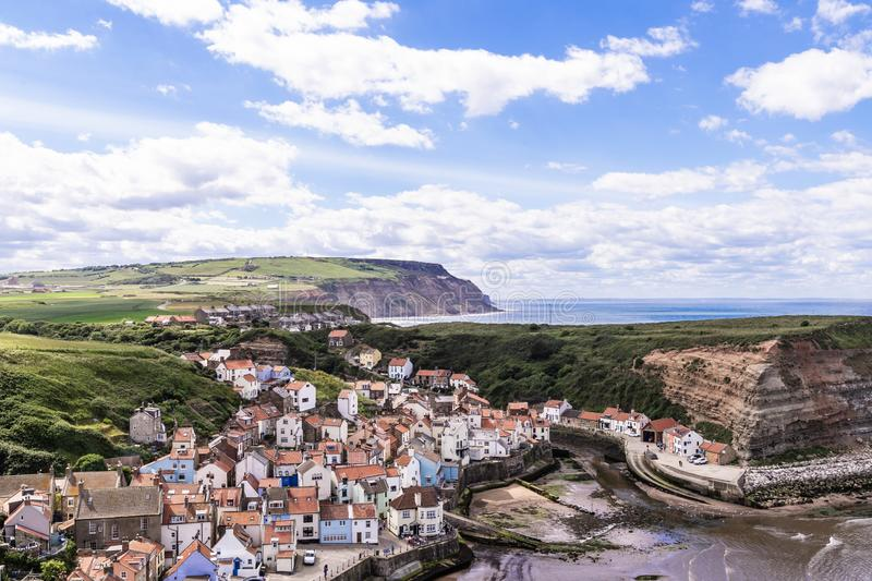 A view of the North Yorkshire UK villages of Staithes and Cowbar, seen here from from Penny Nab headland. stock image