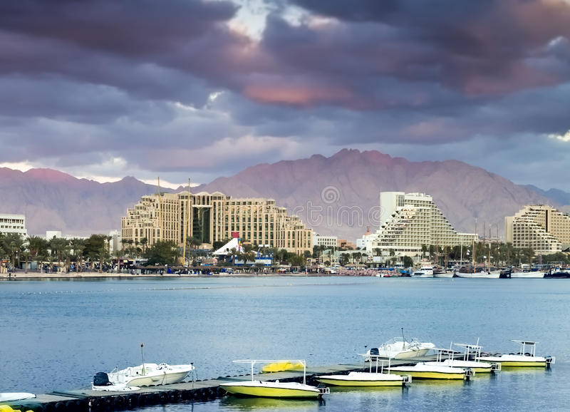 View on norther beach of Eilat, Israel. The city of Eilat is a famous city with beautiful beaches and resort hotels packed with thousands relaxing tourists from royalty free stock photos