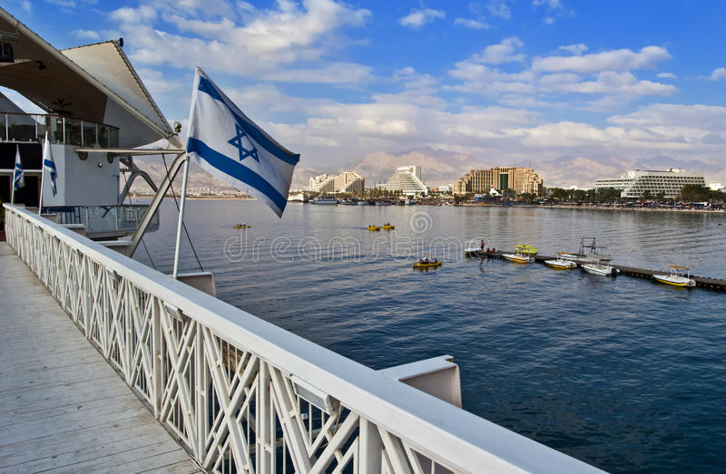 View on norther beach of Eilat, Israel. The city of Eilat is a famous city with beautiful beaches and resort hotels packed with thousands relaxing tourists from stock photo