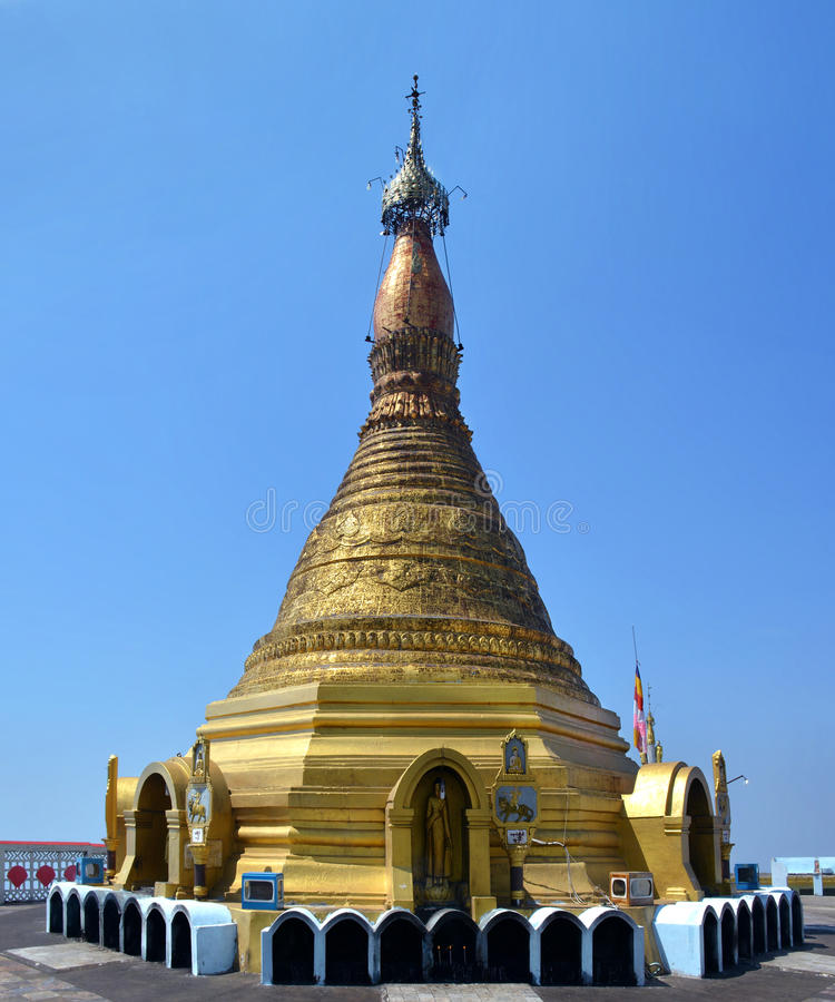 View o the majestic golden stupa on the top of mount Zwegabin, H stock photography