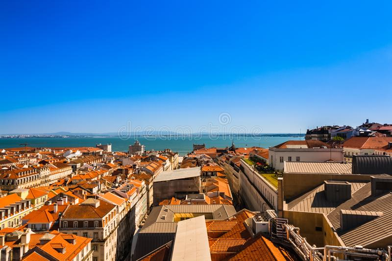 View from observation deck of the Elevador de Santa Justa to the old part of Lisbon. Cityscape with the Lisbon rooftops. Beautiful view from the roof of Santa royalty free stock photos