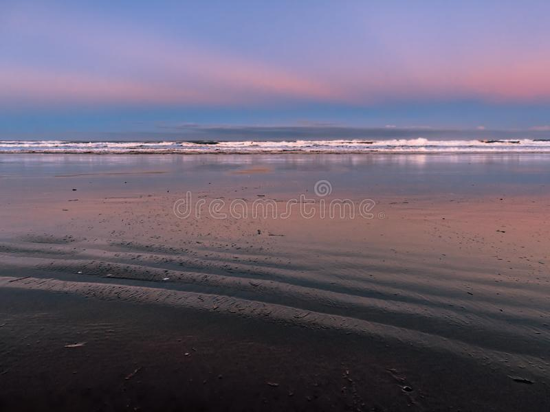 Deserted ocean beach at dawn royalty free stock photography