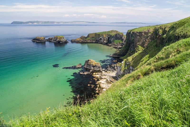 View of the ocean and Carrick-a-Rede island on the coast of County Antrim, Northern Ireland stock images