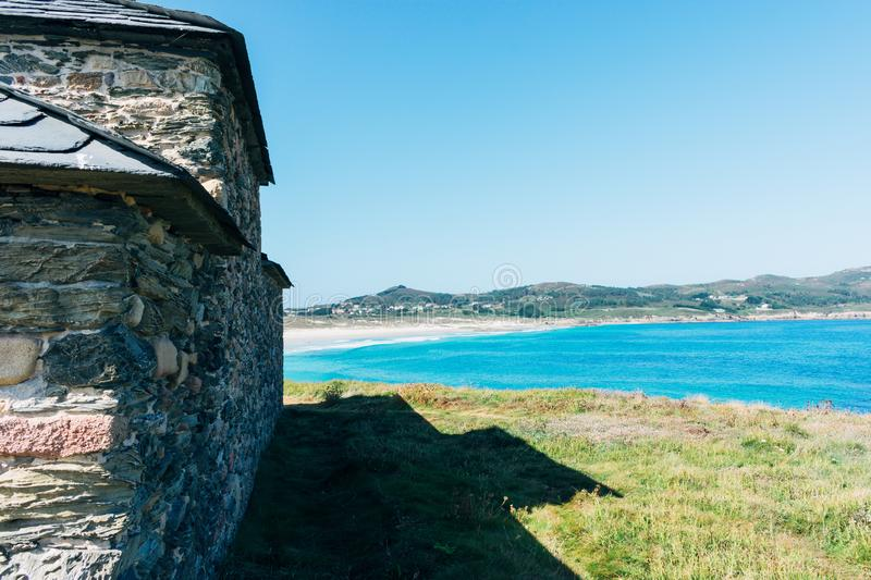 View of the ocean from the medieval stone hermitage on the coast stock photo
