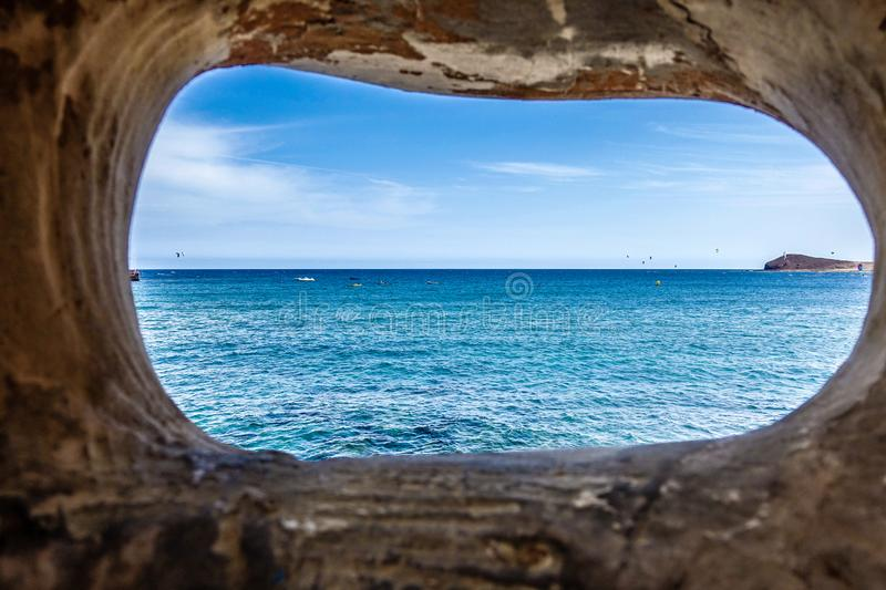 View on the ocean. Tenerife, Spain, view on the ocean from window in the rocks stock image
