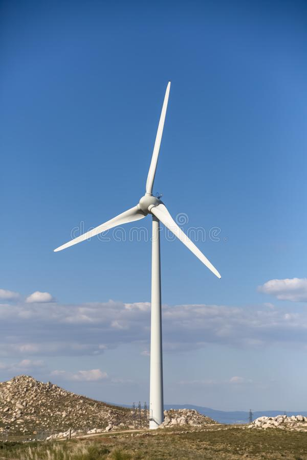 Free View Of A Wind Turbine On Top Of Mountains, Blue Sky As Background Royalty Free Stock Photo - 163266665