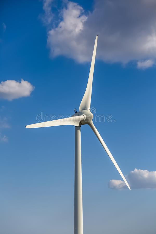 Free View Of A Wind Turbine On Top Of Mountains, Blue Sky As Background View Of A Wind Turbine On Top Of Mountains, Blue Sky As Royalty Free Stock Photography - 160206517