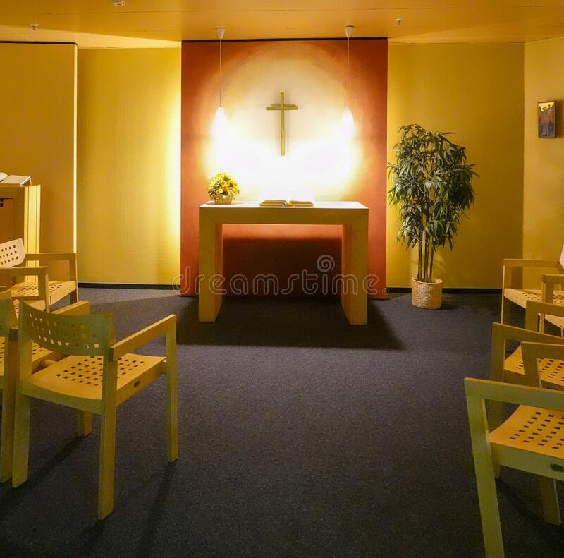 Free View Of The Christian Chapel In The Airport With Wooden Chairs And A Simple Altar For Prayer And Reading The Bible Royalty Free Stock Images - 186031849