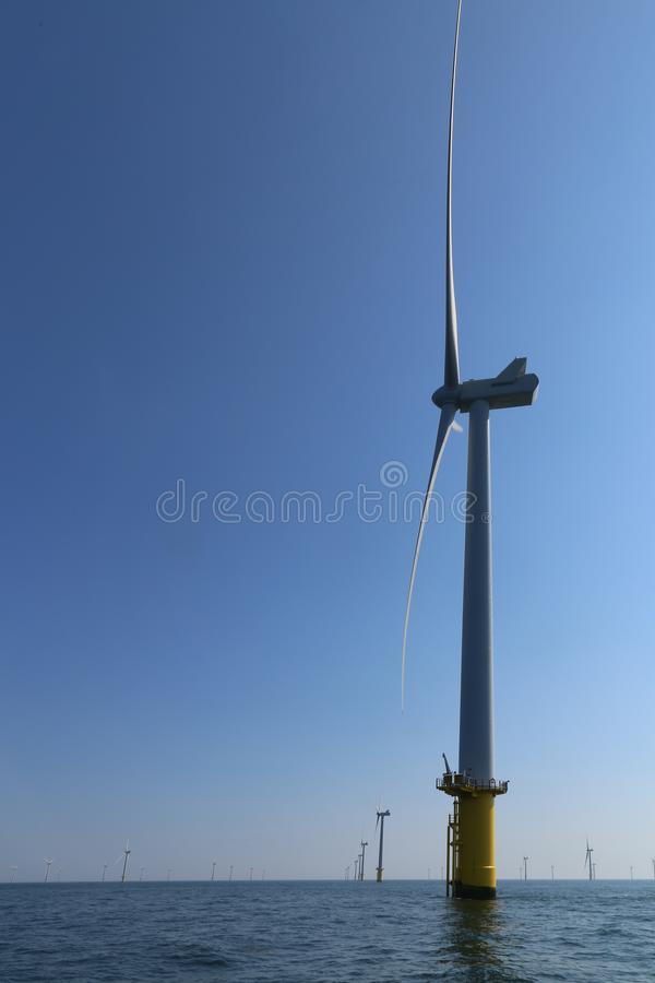 View of the offshore windmills of Rampion windfarm off the coast of Brighton, Sussex, UK stock photography