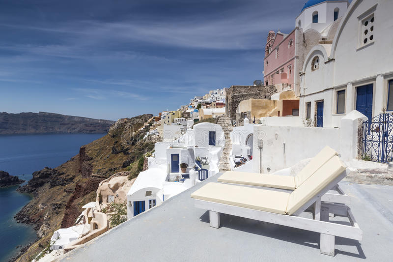 View of Oia traditional white houses of Oia at sunset in Santorini, Greece. stock images