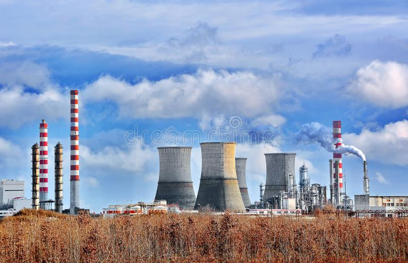 Oil refinery. View of oil petrochemical refinery with cloudy blue sky stock photos