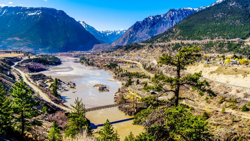 A single lane bridge over the Fraser River at the town of Lillooet, British Columbia, Canada stock image