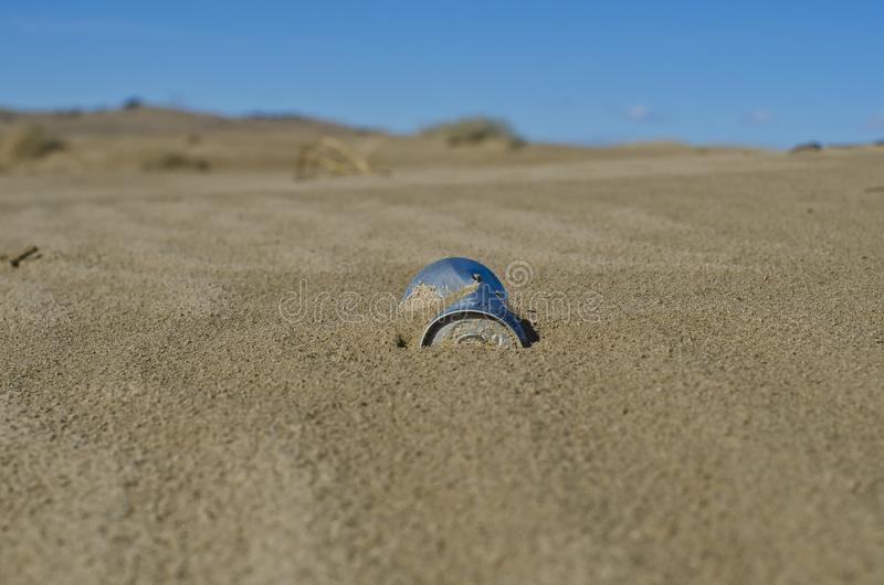 A can stuck in the sand dunes stock images