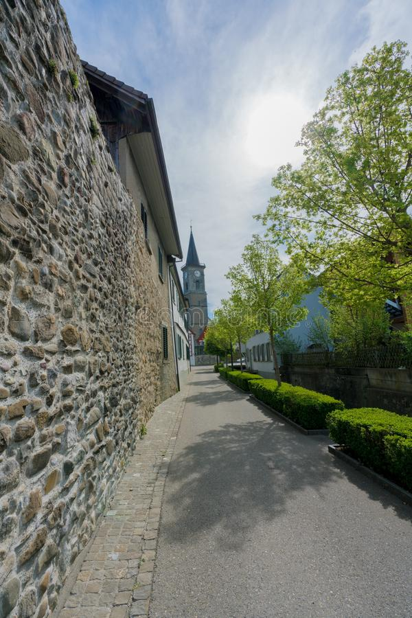 View of the old city wall and church in the Swiss village of Steckborn. On Lake Constance royalty free stock photos