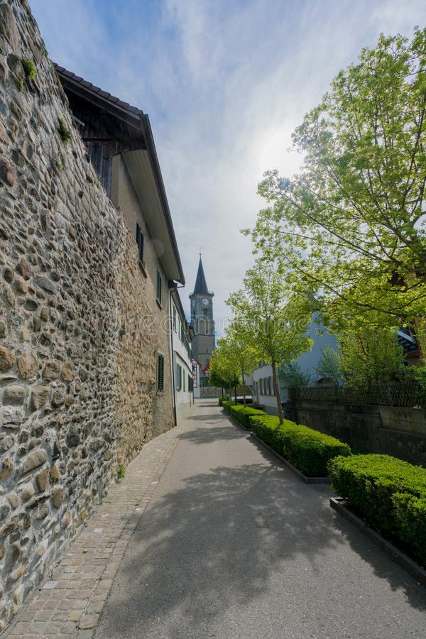 View of the old city wall and church in the Swiss village of Steckborn. On Lake Constance royalty free stock photo