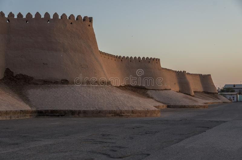 View of old city walls and towers in sunset. Khiva royalty free stock image