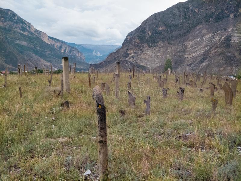 A view on old and closed Caucasus muslim cemetery Gimry stock photo
