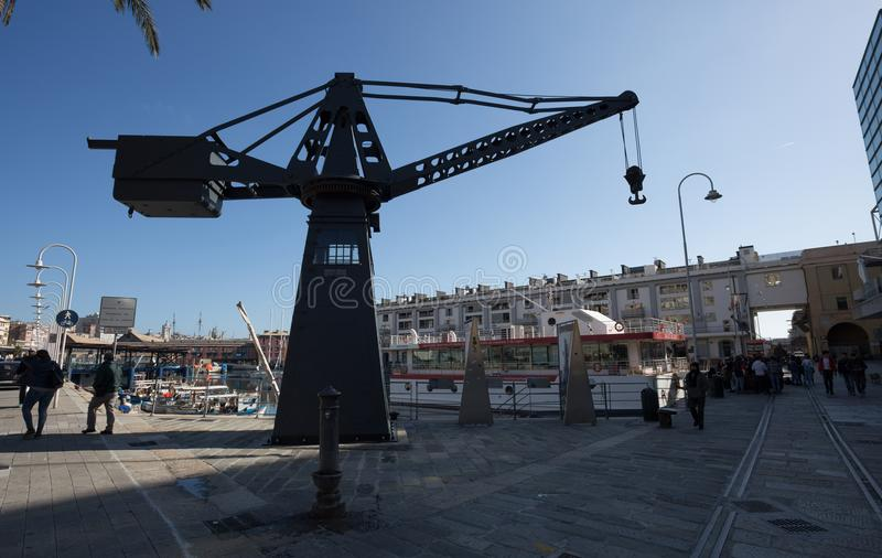 View of an old crane in the port of Genoa, Italy. royalty free stock image