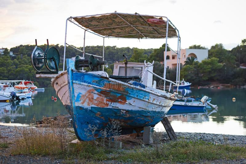 Old greek fishing boat. View of an old greek traditional fishing boat caique stock photography