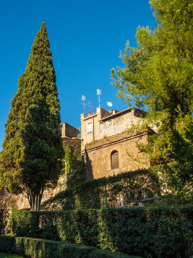 View of old houses from the garden at Villa D`Este in Tivoli, Italy.  royalty free stock photos