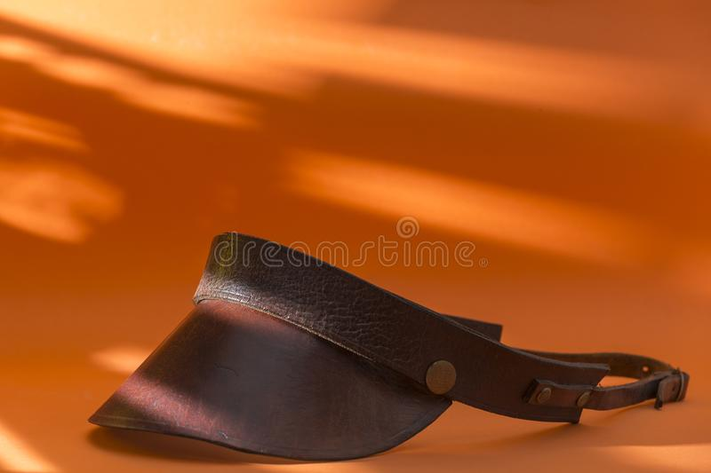 Retro leather visor. View of an old leather visor, of which they were used for lighting work royalty free stock photography