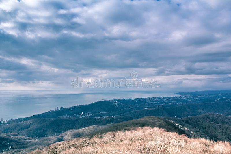 View from the old observation tower on mount Ahun. The old lookout tower on mount Akhun. Ancient architecture. Historical monument. The mountains and the sky royalty free stock image