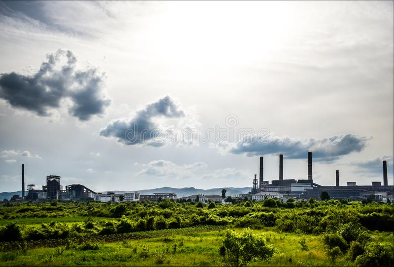 View of old power plant with big concrete furnaces . Fallen chemical communist industry royalty free stock photo