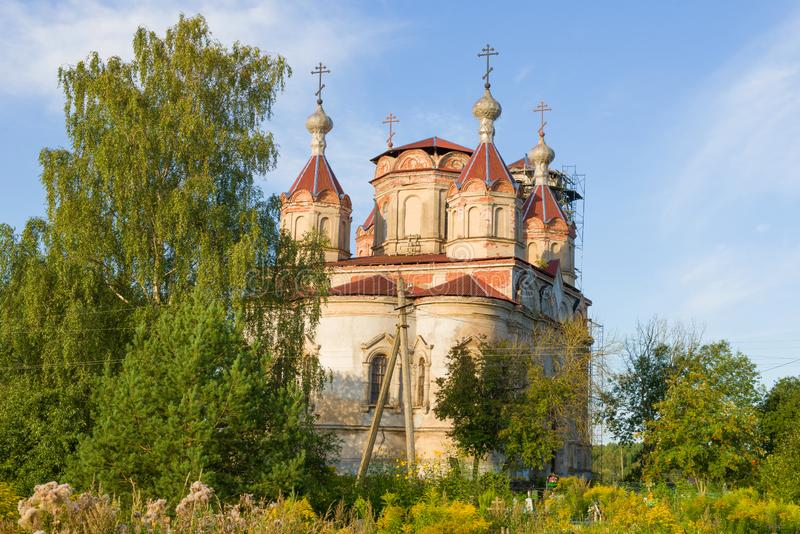 View of the old restored Trinity Church. Issad, Leningrad region. View of the old restored Trinity Church on a sunny August morning. Issad, Leningrad region stock photos