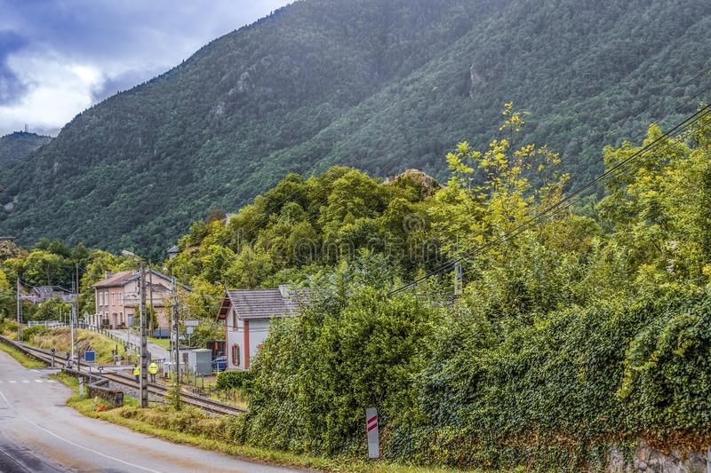View of the old road and station of the village of ax-les-thermes. Ariege France. Near the French-Andorran border we see the station of the village of Ax-les stock photography