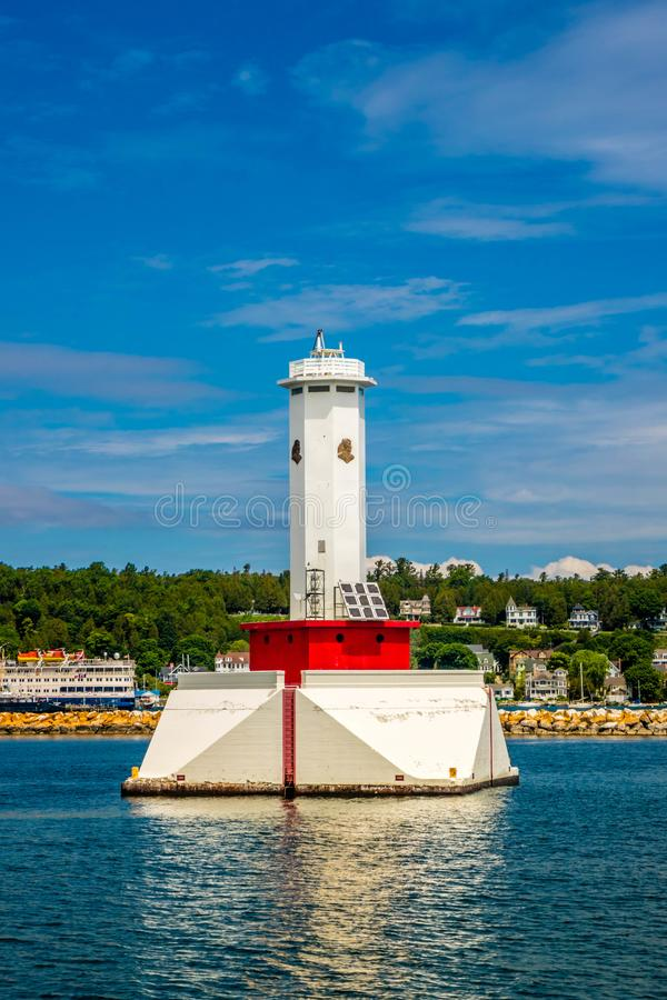Round Island Lighthouse in Mackinac Island St. Ignace, Michigan. The view of Old Round Island Point Lighthouse from the shore of Mackinac Island royalty free stock photos