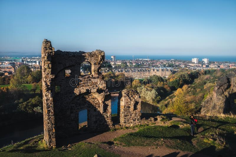 View on the old ruined chapel and city Edinburgh. The only building in the central area of Edinburgh`s Holyrood Park is St Anthon royalty free stock photos