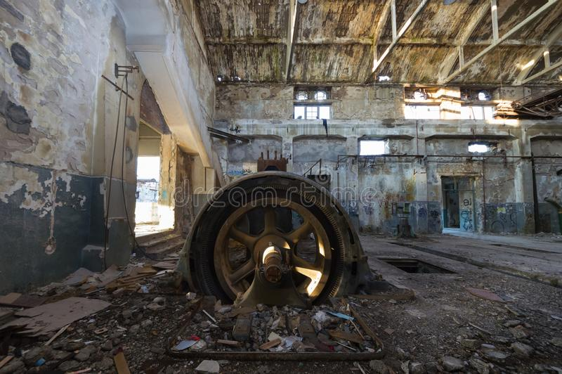 Old rusty engine in an abandoned industrial building royalty free stock image
