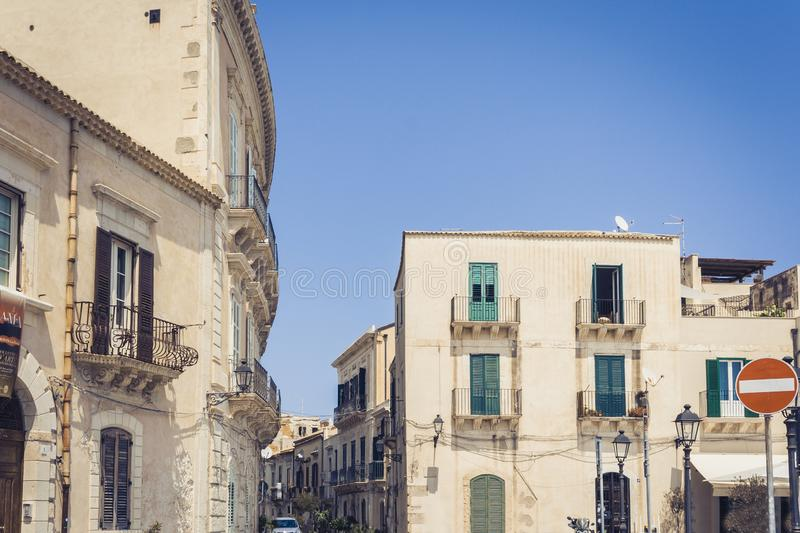 View of old street, facades of ancient buildings in seafront of Ortygia Ortigia Island, Syracuse, Sicily, Italy.  royalty free stock images