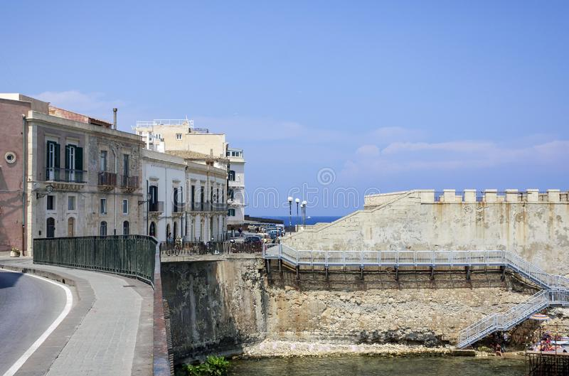 View of old street, facades of ancient buildings in seafront of Ortygia Ortigia Island, Syracuse, Sicily, Italy.  stock image
