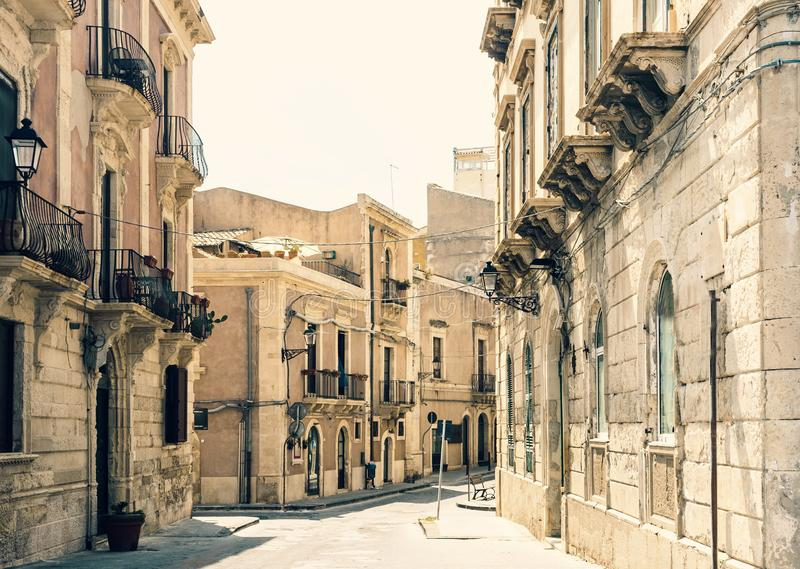View of old street, facades of ancient buildings in seafront of Ortygia Ortigia Island, Syracuse, Sicily, Italy.  stock images