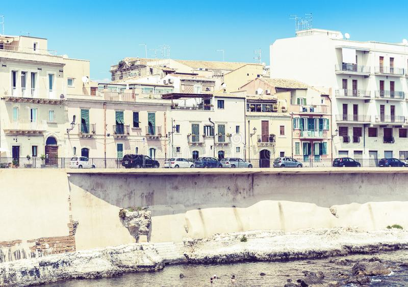 View of old street, facades of ancient buildings in seafront of Ortygia Ortigia Island, Syracuse Siracusa, Sicily, Italy.  royalty free stock photo