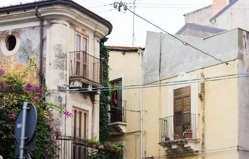 View of old street, facades of ancient buildings. In catania, Sicily, Italy stock image