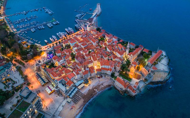 View of the Old Town Budva at night. View of the Old Town Budva at night by drone royalty free stock photo
