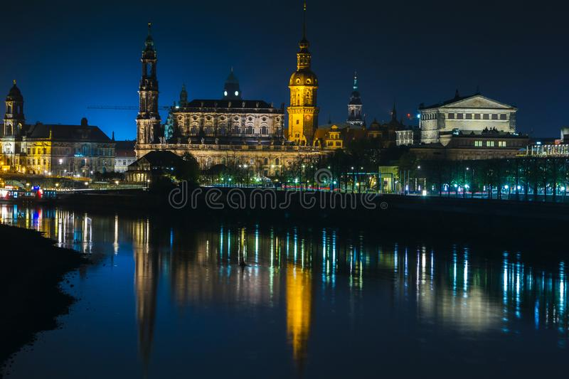 View of the old town of Dresden at night with a view of water and the reflection of the city as well as, churches, towers and bui. Ldings. Elbe river. Germany stock photo