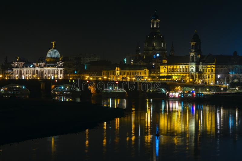 View of the old town of Dresden at night with a view of water and the reflection of the city as well as, churches, towers and bui. Ldings. Elbe river. Germany stock photos