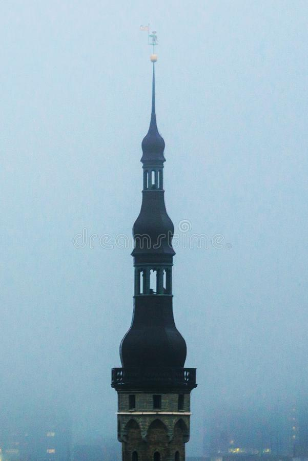 View of the old town in foggy weather. Town Hall spire. Toompea district. Tallinn, Estonia.  royalty free stock photography