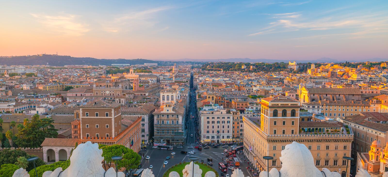 View of old town Rome skyline in Italy. At sunset royalty free stock photography