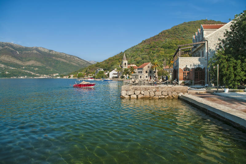 View of old town by sea. View of Church of Saint Roch by sea near Tivat, Montenegro royalty free stock photography