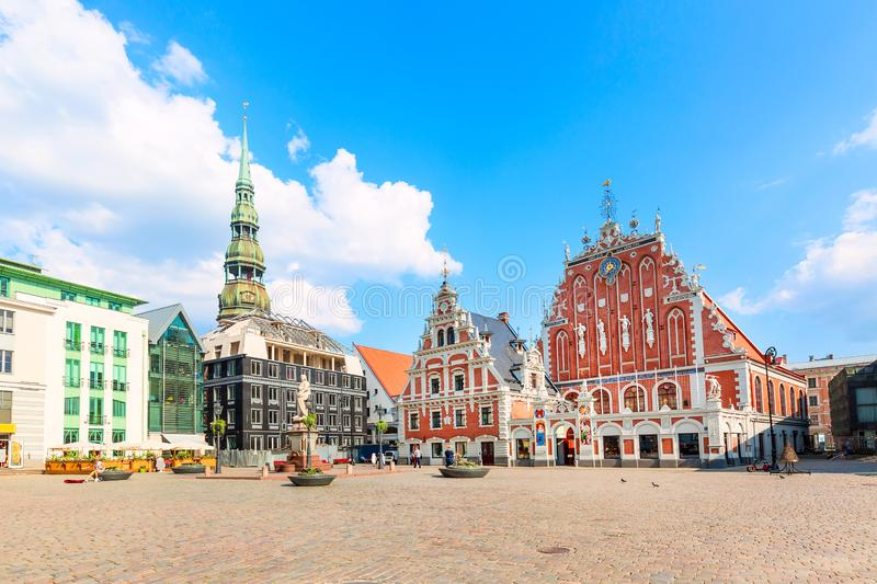View of the Old Town square, Roland Statue, The Blackheads House near St Peters Cathedral against blue sky in Riga, Latvia. Summer royalty free stock images