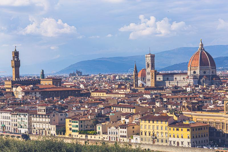 Florence, Tuscany, Italy: Panoramic view of the old town with towering Cathedral of Santa Maria del Fiore and Giotto`s royalty free stock photos