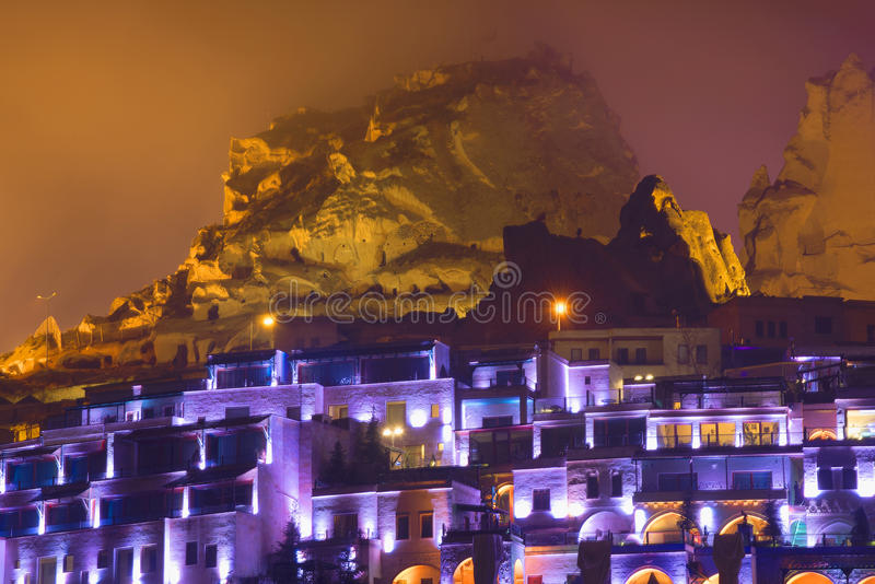 View of the old town of Uchisar foggy night. Cappadocia royalty free stock photos